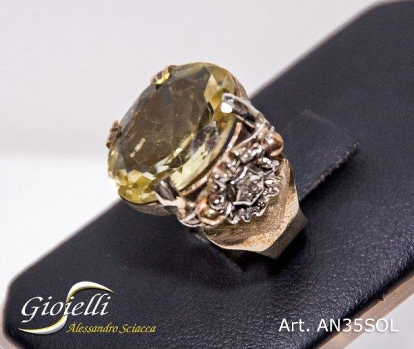 Anello a fascia con pietra centrale topazio lemon e diamante