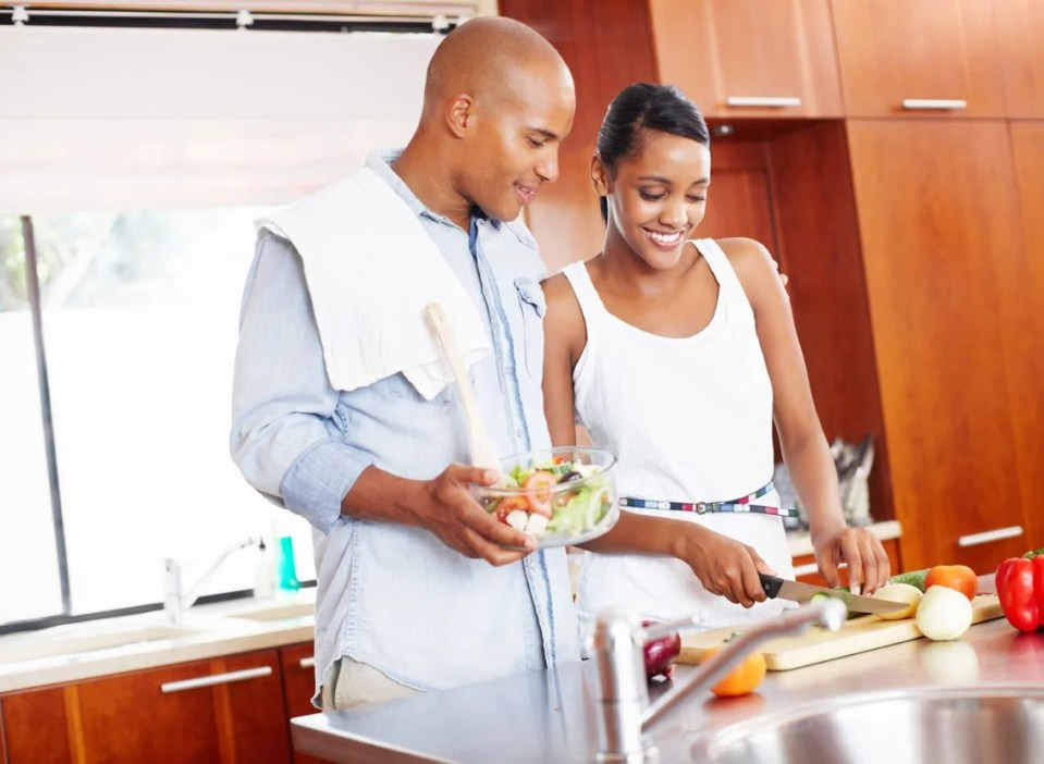 Image result for an african man  and woman cooking