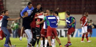Huracan's players celebrate at the end of their Copa Sudamericana semi-final soccer match against River Plate, in Buenos Aires, Argentina