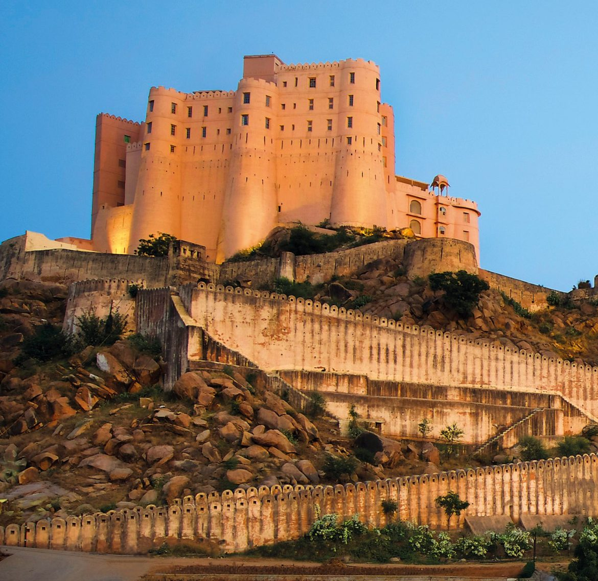 Set on a granite hill, the watchful fortress looks out over the Aravalli Range