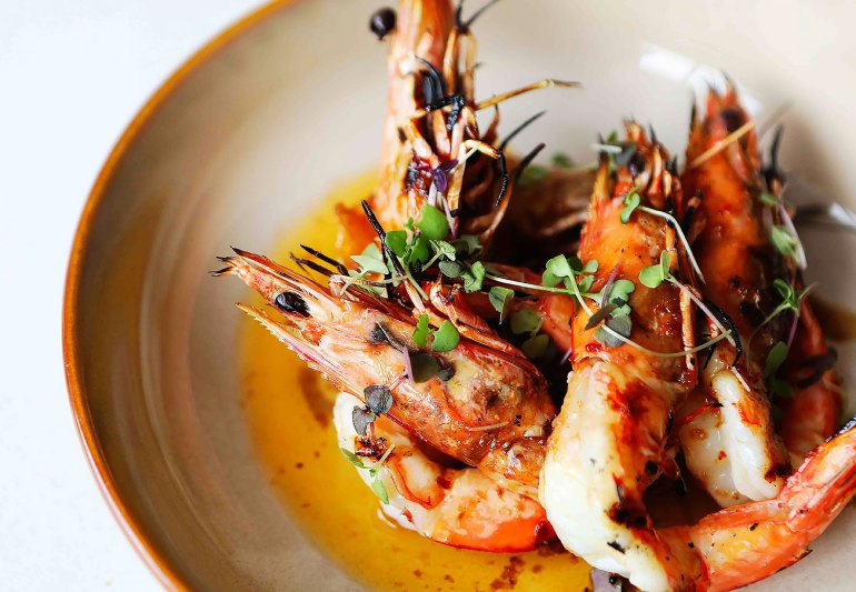 Wonderfully charred smokey flavours are a feature of the locally caught BBQ prawns