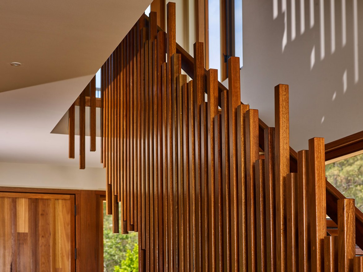 The home's balustrade is similar in feel to the timber matchstick-layering effect of Canberra's Ovolo Hotel entry