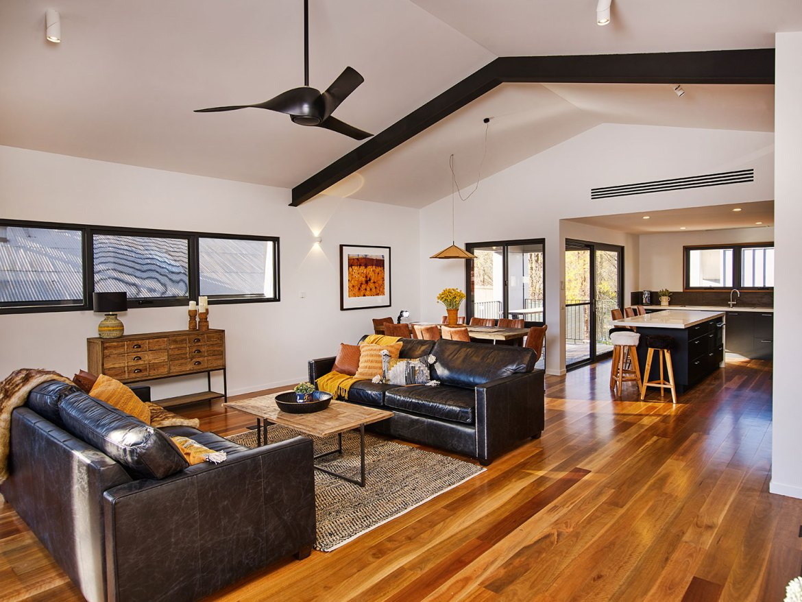 Art House Townhouses Penthouse featurs expose steel beams and select grade spotted gum polished floors