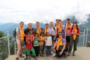 Young People standing in Barpak with local young people