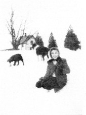Barbara (me) in Essex. In the distance is the cottage that Dr. Morch and the Slakins rented from the farm. This is the only picture I have of it as the cottage is gone now.