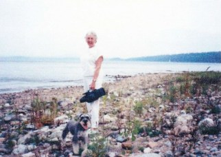 Barbara Irish Smith at Whallons Bay with Split Rock in the background.