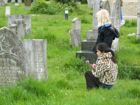 Students from Westborough Primary School searching the gravestones for people's stories
