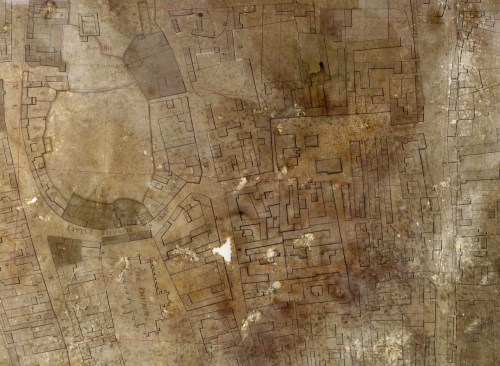 After conservation work. The map is still very dark due to the layer of discoloured varnish which cannot be removed, but it has been flattened and tears and holes filled in. Despite the damage it has suffered, the outlines of the streets and buildings are remarkably clear.