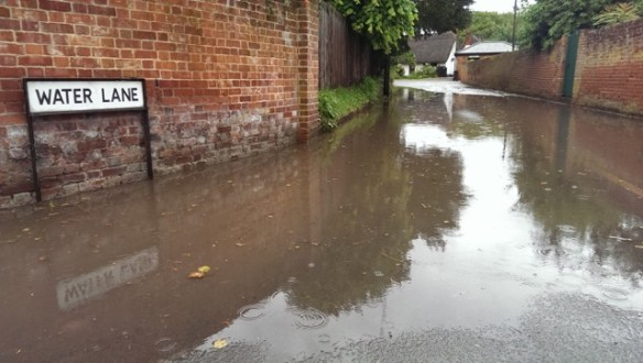 Photograph of large puddle on Water Lane
