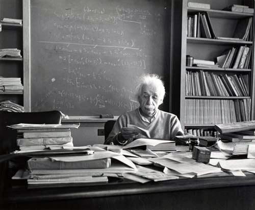 Albert Einstein at his desk