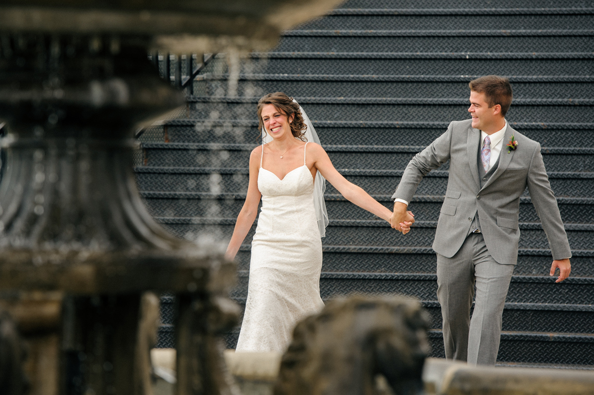 Emotional wedding photo of bride and groom entering ceremony hand in hand at Chateau Saint-Ambroise, Montreal