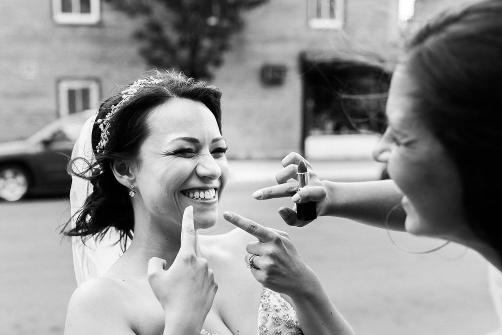 Bridesmaid fixing lipstick