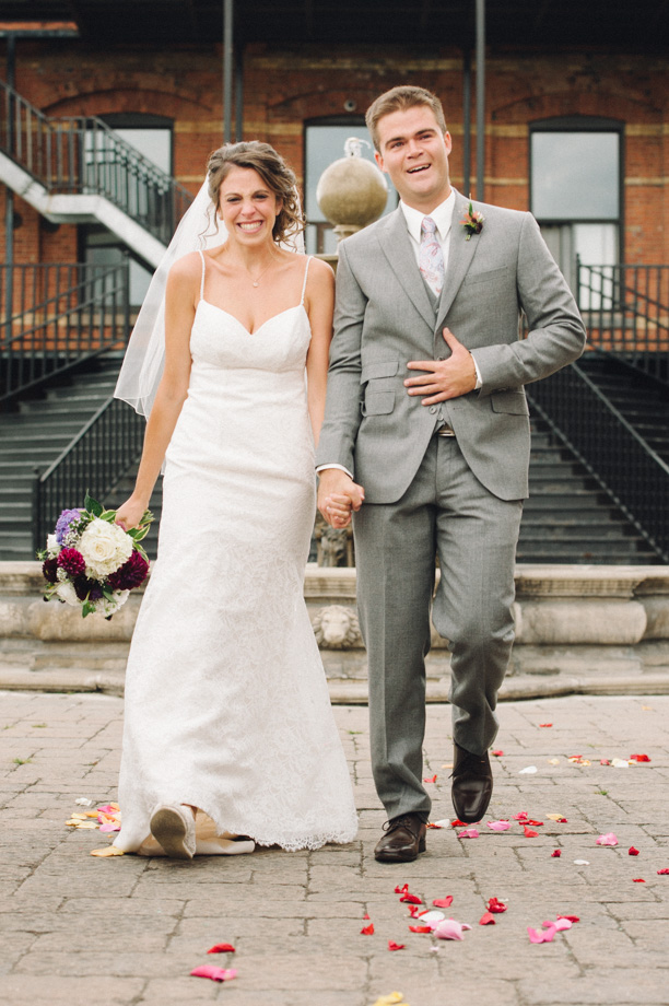 Emotional bride and groom walking together