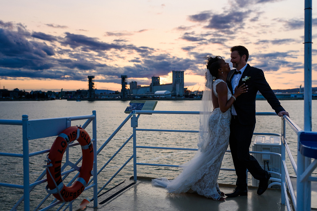 Romantic sunset wedding photo on boat in Quebec City