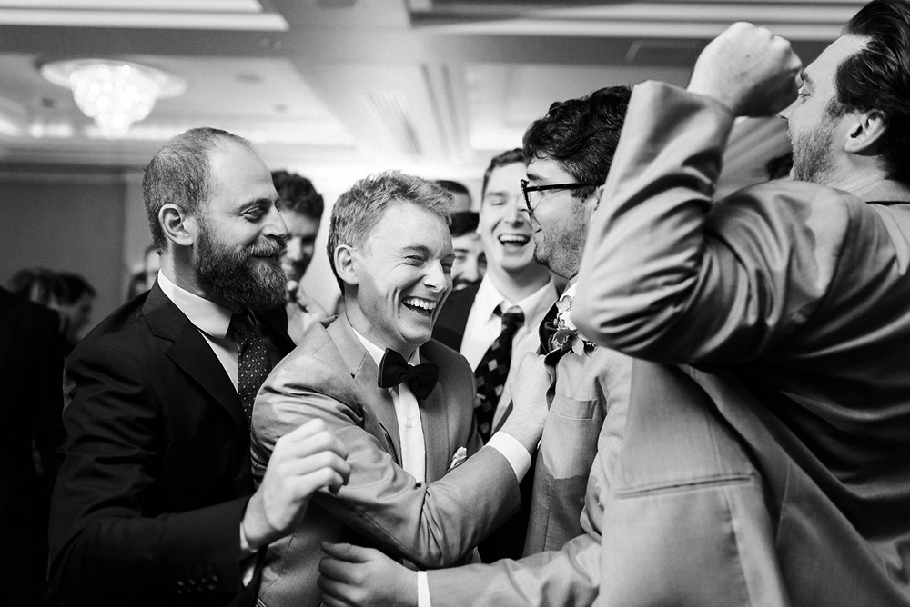 Groom and friends dancing at the wedding party at Loews Hotel Vogue, Montreal