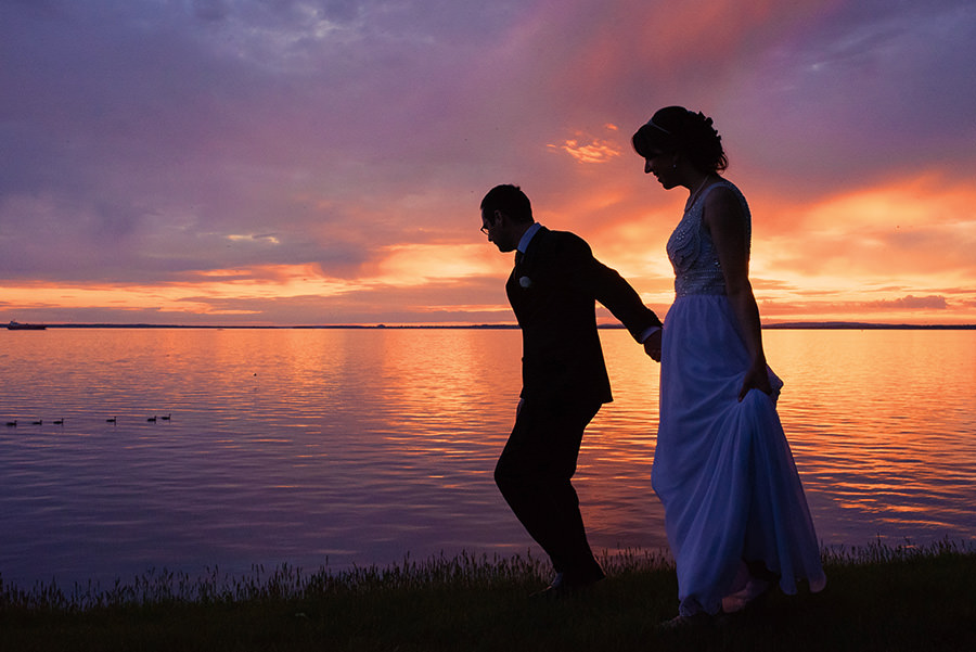 Silhouette of wedding couple against the sunset