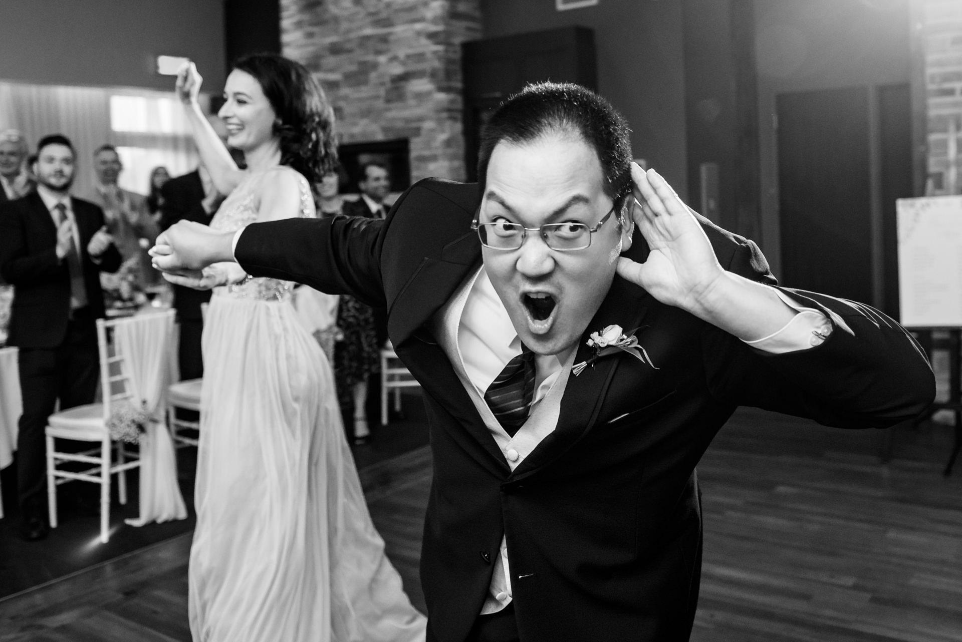 Groomsman entrance during wedding reception
