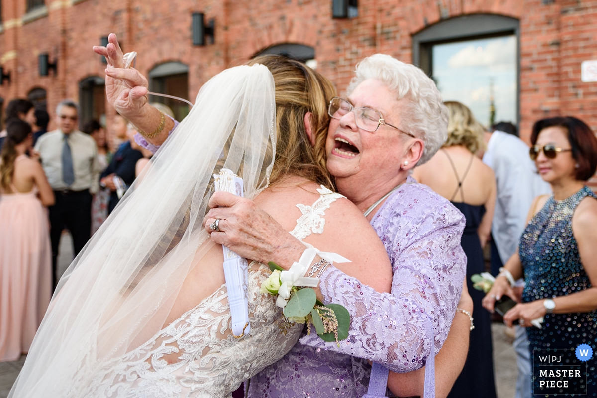 Award-winning wedding photo of bride's emotional grandmother
