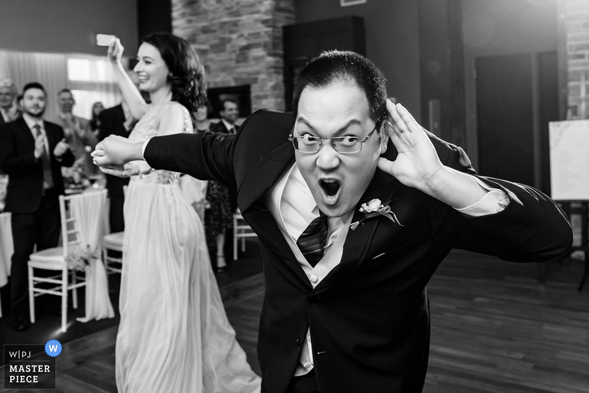 Award-winning wedding photo of groomsman entrance