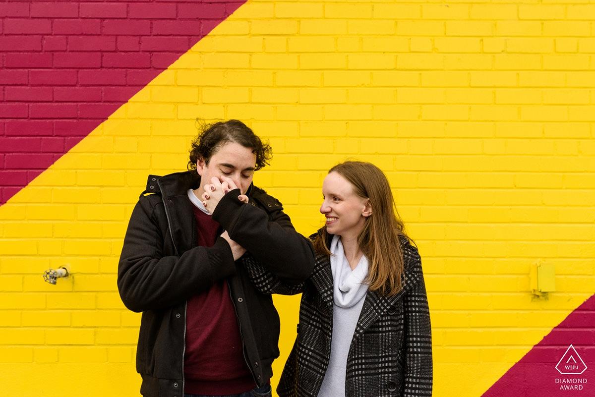 Award-winning engagement photo of couple with graffiti murale