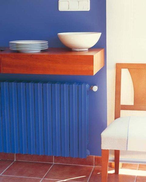 Cubrir radiadores mueble cubre radiador colocar un for Muebles para cubrir radiadores