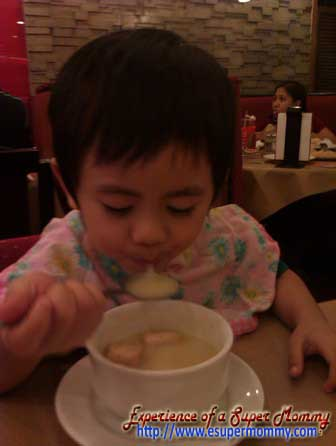 Filipino toddler using a spoon