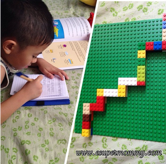 Child writing and Lego activity