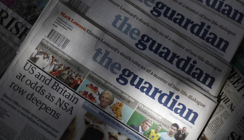Copies of the Guardian newspaper are displayed at a news agent in London
