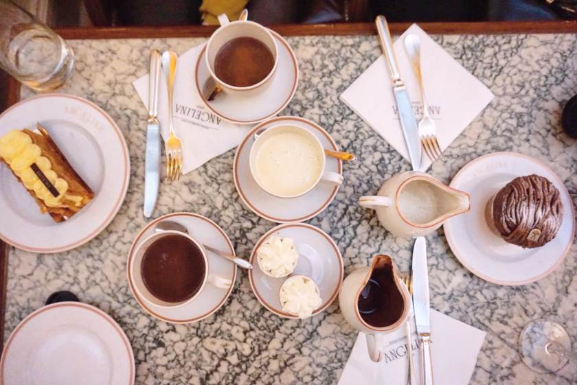 Table spread of hot chocolates and pastries at Angelina Paris