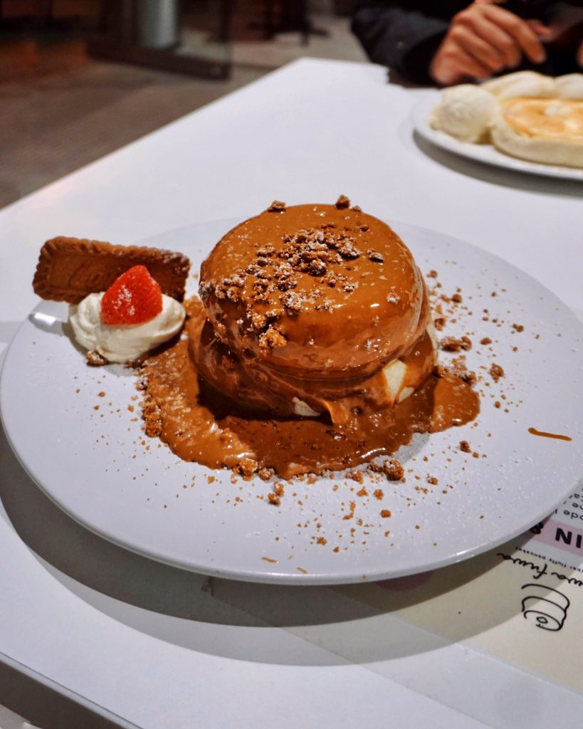 Image of a stack of Japanese souffle pancakes drenched in Lotus Biscoff Sauce at Fuwa Fuwa