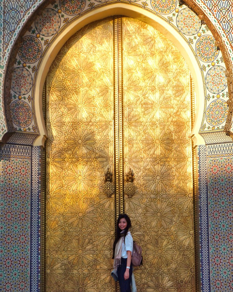 Tall ornate golden doors of the Royal Palace of Fez, Morocco