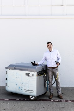 Arcady Sosinov, CEO & Founder of FreeWire, poses with the Mobi unit in San Leandro