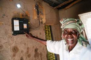 Elizabeth Mukwimba is a 62-year-old Tanzanian woman who now has solar lighting and electricity in her home at the flick of a switch, thanks to an off-grid project.  Photo from Off-Grid Electric.