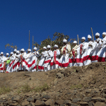 The clergy and Debtera (scholars versed in the liturgy and music of the church) lift their voices in hymn and chant just as it has been for over a 1,500 years when Ethiopia accepted Christianity.