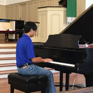 "LUIANGELO MONTES, STUDENT OF BRIAN BRAQUET, PLAYS "" FANTASIA IN d"" BY MOZART."
