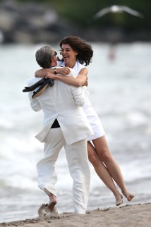Katie Holmes Giddily Channels Jackie . Set Of '