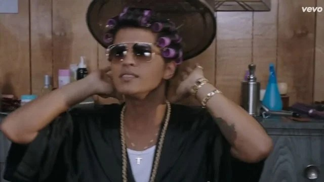 Bruno Mars Tries To Make Gold Hair Rollers Happen