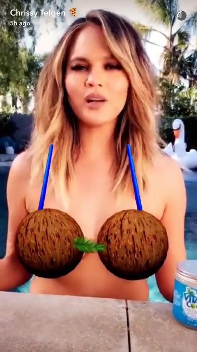 Chrissy Teigen Strips Down to Bra Made of Coconut Emojis