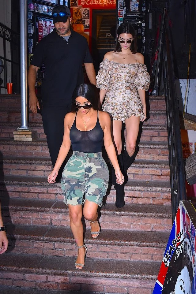 Kim Kardashian Rocks Another EyePopping Ensemble Goes Braless in a Sheer Top and Camo Shorts