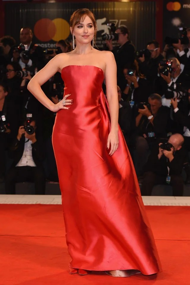 Dakota Johnson Is a Vision in Red at Venice Film Festival  See the Mesmerizing Gown