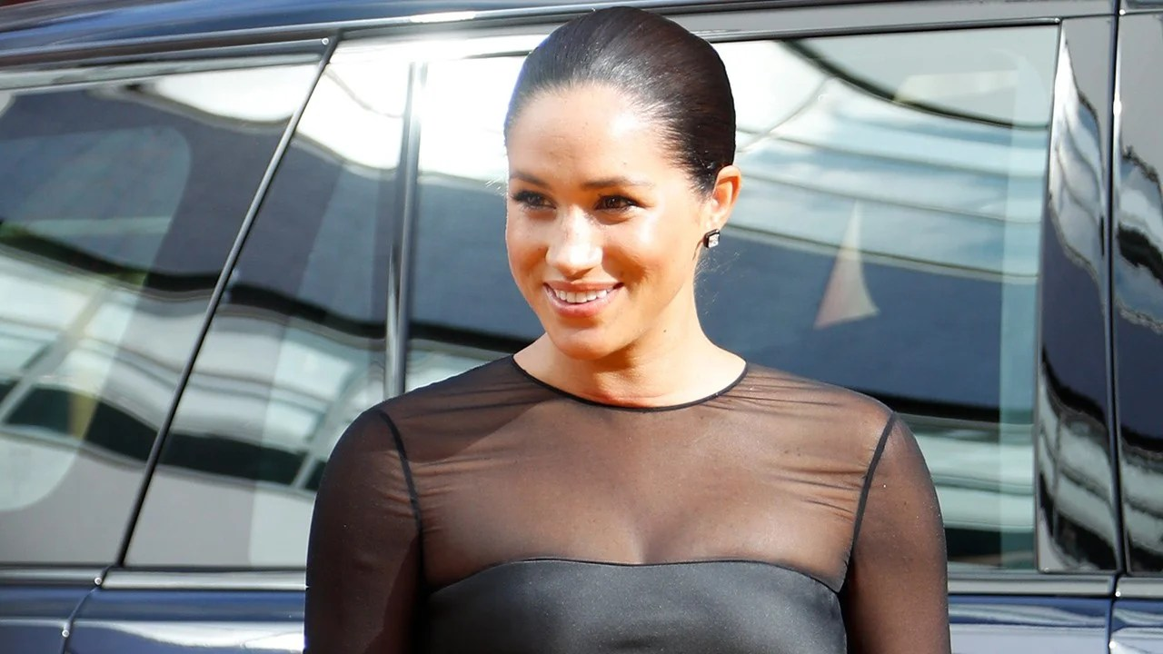 Meghan Markle Dazzles In Black Dress At Lion King