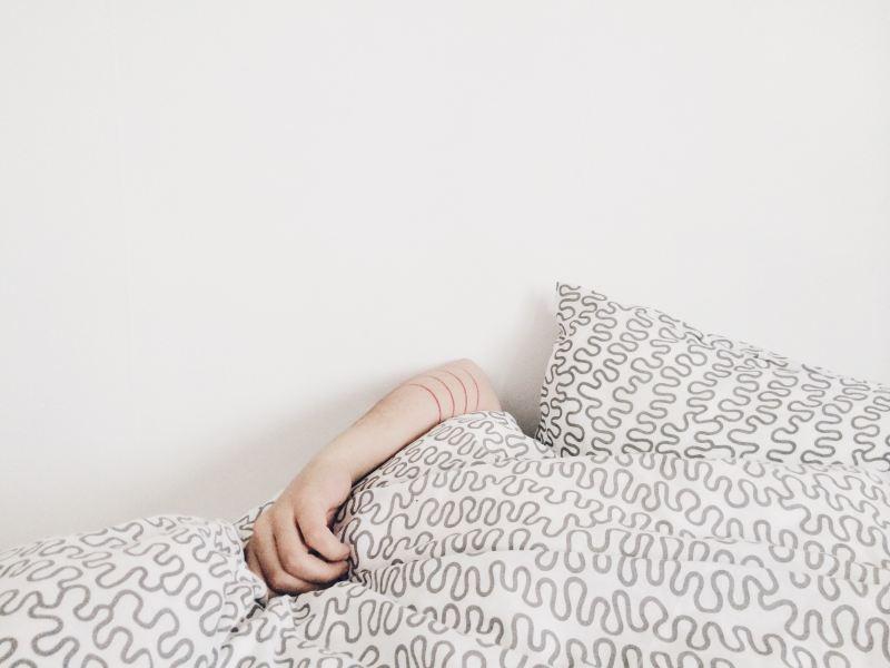 girl's hand on pillow