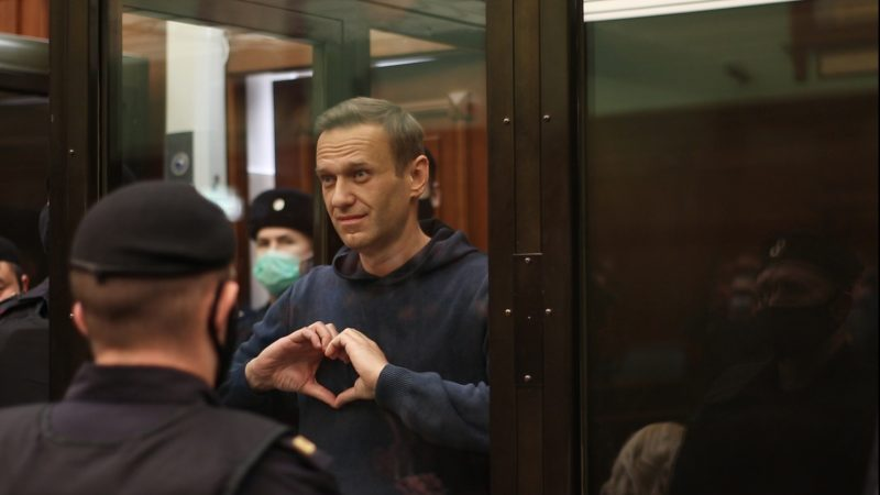 Russia to try Navalny for slander amid EU talks
