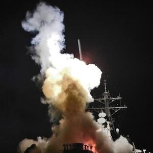 March 19, 2011 photo provided by the U.S. Navy shows the guided-missile destroyer USS Barry (DDG 52) as it launches a Tomahawk missile in support of Operation Odyssey Dawn from the Mediterranean Sea. Photo: U.S. Navy, Fireman Roderick Eubanks