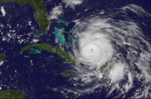 The GOES-13 satellite saw Hurricane Irene entering the Bahamas on Aug. 24, 2011 at 1302 UTC (9:02 a.m. EDT). Irene became a major hurricane shortly before this image and now has a clear, visible eye.  Credit: Credit: NASA/NOAA GOES Project