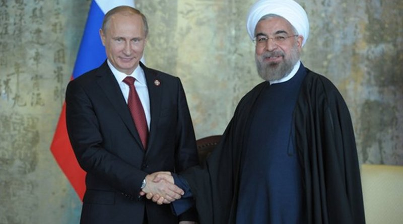 File photo of Russia's Vladimir Putin with Iran's Hassan Rouhani taken at 2014 CICA summit. Photo Credit: Russia's Presidential Press and Information Office, www.kremlin.ru, Wikimedia Commons.