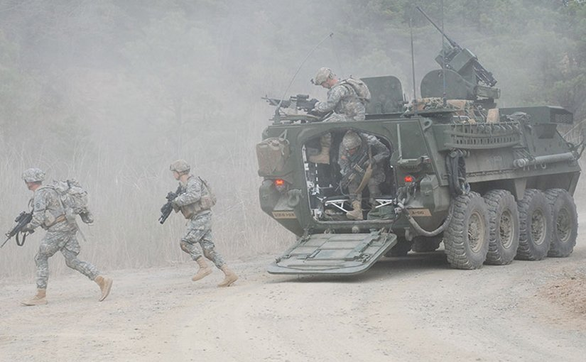 Soldiers dismount from Stryker vehicle during Foal Eagle 2012 as part of Combined Arms Live Fire Exercise at Rodriguez Range Complex, South Korea (U.S. Army)