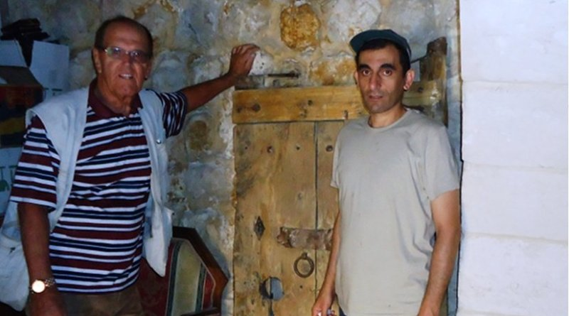 An American visitor and his guide Jesus (Issa) with the 1,700 year old door of St. Trecla, which was stolen on 9/13/2013 was returned in February 2015 when it was discovered in Lebanon's Bekaa valley.