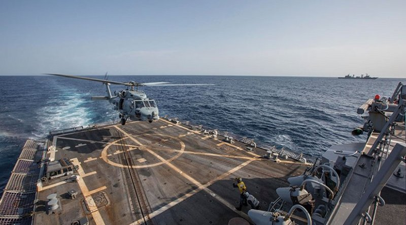 """MH-60S Seahawk helicopter assigned to """"Swamp Foxes"""" of Maritime Helicopter Combat Squadron 74 departs USS Mason during U.S.-China cross-deck landing exercise with People's Liberation Army Navy destroyer Harbin (U.S. Navy/Rob Aylward)"""