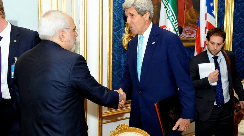 U.S. Secretary of State John Kerry shakes hands with Iranian Foreign Minister Mohammad Javad Zarif in Vienna, Austria, on July 13, 2014, before they begin a bilateral meeting focused on Iran's nuclear program. Photo Credit: US State Department.